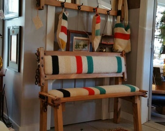 Custom made antique double  cow stanchion bench with back and seat cushion upholstered into original antique hudson bay blanket.