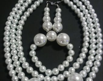 Triple strand faux pearl necklace set with earrings and bracelet