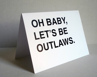 Oh Baby, Let's Be Outlaws Greeting Card