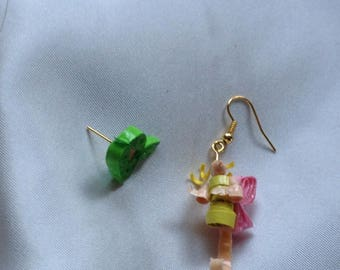 A pair of earrings different. A magical world ears, a fairy and a Bush.