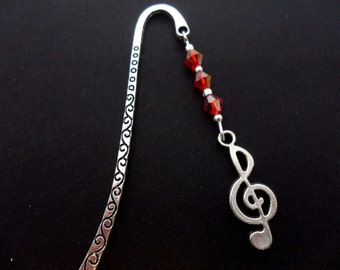 A tibetan silver and treble clef musical note charm  & red crystal  bookmark.