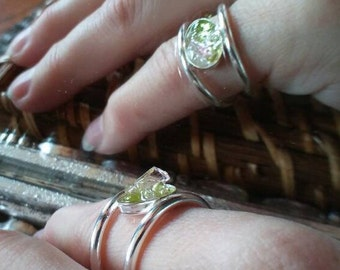 Peridot, tourmaline, Herkimer oh my! Set in resin with a fine silver double band size 7