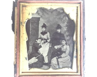 Cased 1/6th group tintype with umbrellas and hats, antique photo