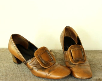 1960s pilgrim shoes, vintage 60s pumps, womens size 8 with chunky heel, large buckle by Personality . distressed orange ish brown vinyl