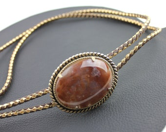 Reddish Brown Stone Set in Gold Bolo Tie