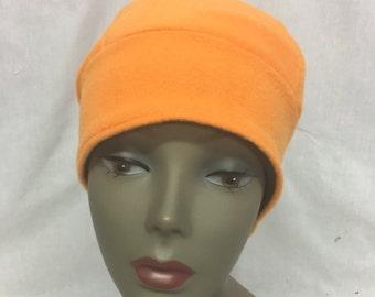 Bright orange fleece cap unlined