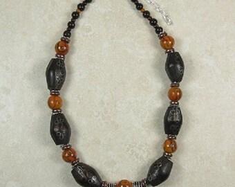 Dark wood and orange beaded necklace
