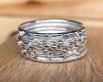 Set of 6 textured stacking rings with aquamarines in sterling silver