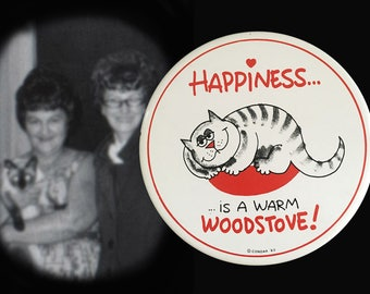 "1983  ""Happiness is a Warm Woodstove"" Cat Trivet by Condar"