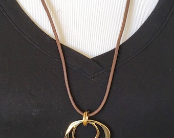 The mattie gold tone metal two circle eyeglass necklace
