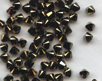 T4 5328 D *** 20 bicone beads crystal Swarovski 5mm CRYSTAL DORADO 2x