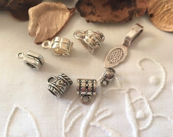 mixed lot of 7 bails, antique silver color and shiny