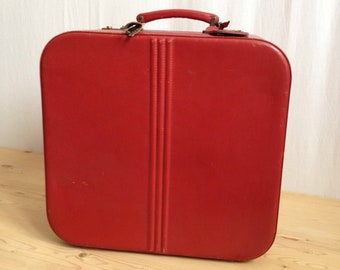 50 year old classic red suitcase