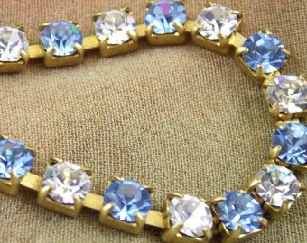 32PP, Light Sapphire, and Crystal Rhinestone, Cup Chain in a Gold Brass Plated Settings.