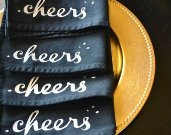 Holiday CHEERS Napkins Screen Printed on Black Cloth Napkins ... SET of  FOUR