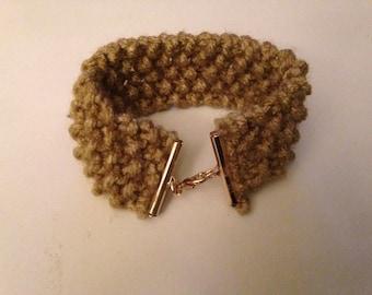 Hand knitted bracelet