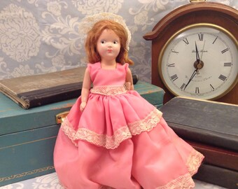 Beautiful Vintage Doll with brown hair and pink dress