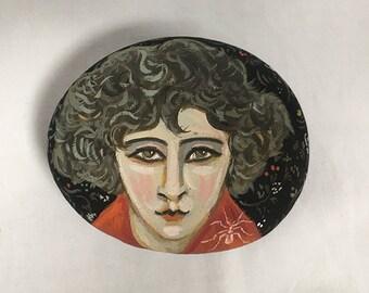 Painted stone. Portrait of Colette.