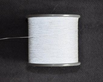 1 spool 200 g reflective yarn BP 139,00 Euro/kg both sides  Nm 35 grey 35.000 m/kg on a cone