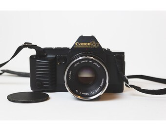 Canon T70 35mm Film Camera with 50mm 1.8 Lens Excellent Condition and Original Case and Strap