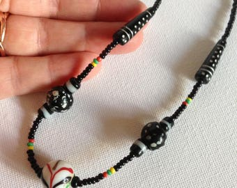 Necklace - black glass bead necklace with coloured pattern - very pretty
