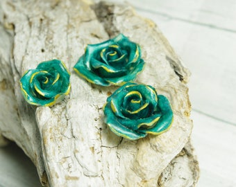 3 turquoise roses molded of cold porcelain