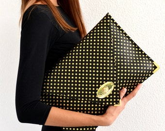 Black leather clutch with gold dots