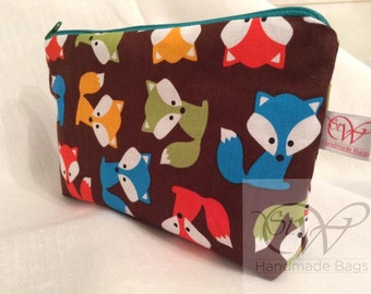 Colourful Foxes make up bag with a waterproof fabric lining.