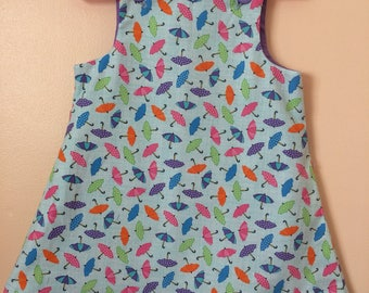 Umbrella patterned pinafore dress