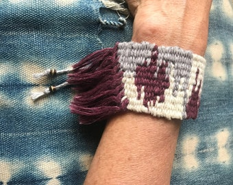 Handwoven cuff bracelet with fringe, made with naturally dyed linen and hemp