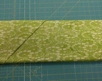 Batik fabric. Celery green dots circles bubbles quilters quilting cotton Hoffman