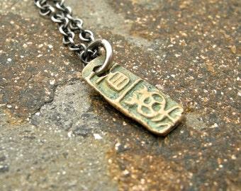 bronze pendant necklace, petroglyph necklace, handmade bronze pendant, yellow bronze necklace, bronze charm necklace