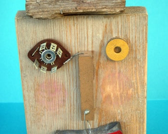 art on wood block, face art, mask, robot, mixed media, found items, recycled, rectangle art, wall art, sculpture, tribal, face on wood