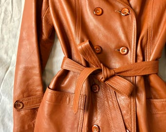 Double breasted jacket: brown leather, vintage, 70s