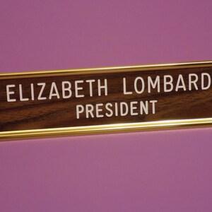 """Custom Engraved Desk Sign - 2"""" x 8"""" - walnut/white letters - gold aluminum desk holder"""