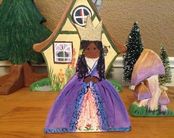 Princess Ari in a purple gown