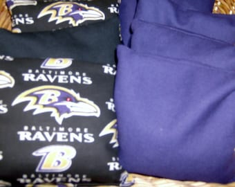 8 PC set of Corn Hole Game Bags 4 Baltimore Ravens with 4 Purple Duck Cloth bags.