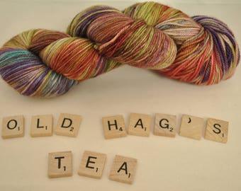 "Hand-dyed yarn, ""Old Hag's Tea"" variegated, soft and squishy yarn. Great for socks or shawls. 80/20 Superwash wool/Nylon"