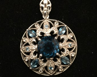Ornate Sterling Round Pendant with Dark Blue Stones