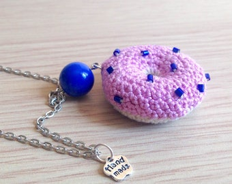 Long necklace with pink and blue amigurumi doughnut