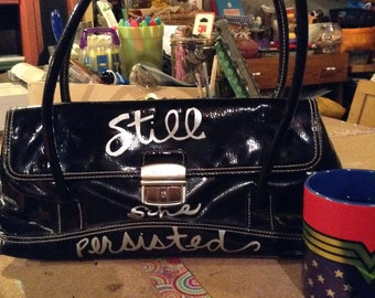Hand painted Still She Persisted black purse free domestic shipping