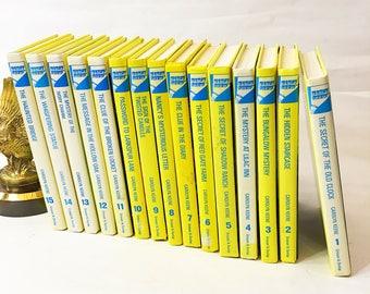 Vintage Nancy Drew Mystery Stories books.  Volumes 1-15 Hardbacks in good condition.  Carolyn keene.