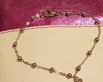 Bracelet with four leaf charms