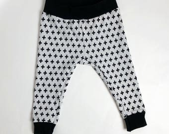 White and black cross pants