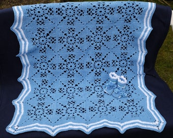Blue cover with baby booties.