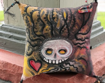 Skull with Tree and Heart, a pillow