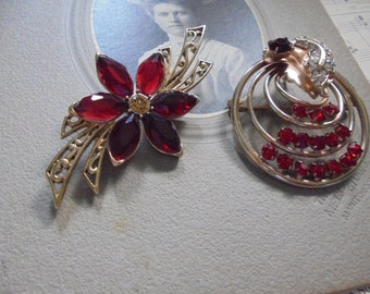 Pretty pair of brooches with red stones
