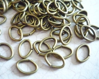 Antiqued Brass Color Oval Jump Rings 18 gauge 8 X 6mm - Qty 88 pieces
