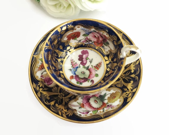 Antique Coalport hand painted cup and saucer, bunches of flowers, cobalt blue background with lots of gilt, collector's set, 1800 - 1820