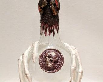 "Decorative Potion ""coffin liquor"" bottle with skeleton hands - Altered bottle"